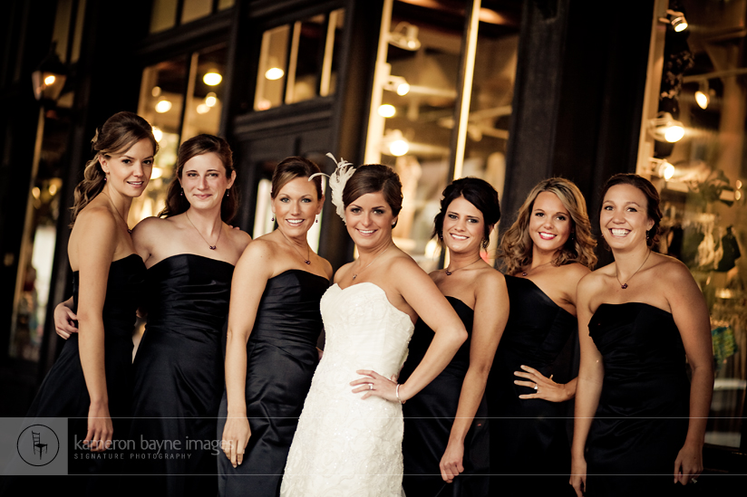 Bayne Images Fashionable Bridesmaids outside Old Market Store Front