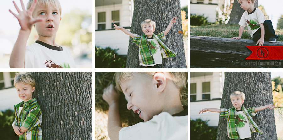 A boy throws leaves in the air, laughs and jumps down into the grass for hours of home-made fun.