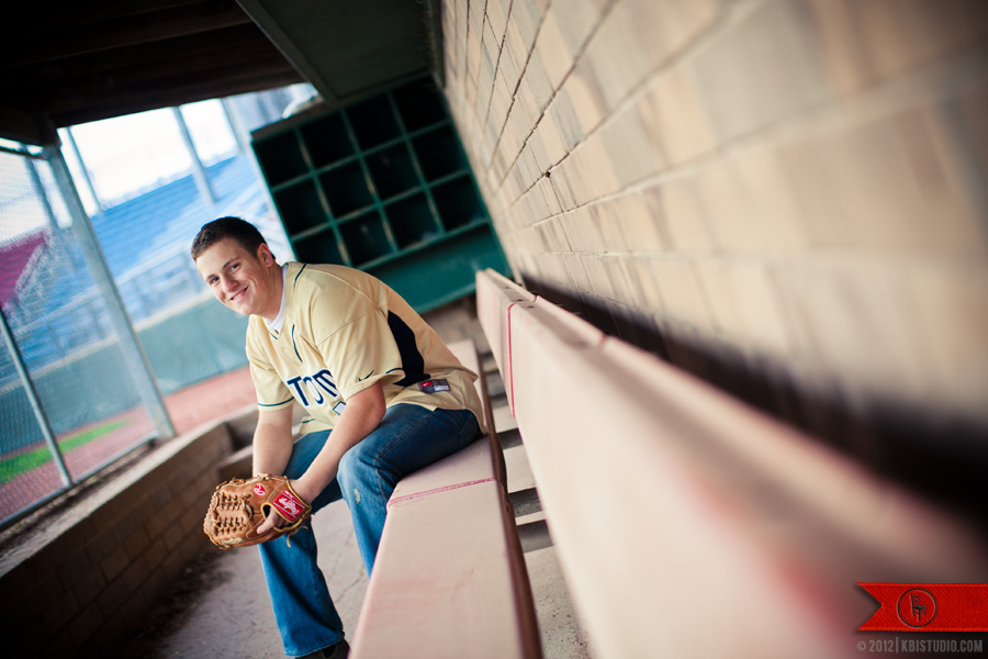 High school senior, Jacob, sits in the dugout of the Elkhorn baseball field.